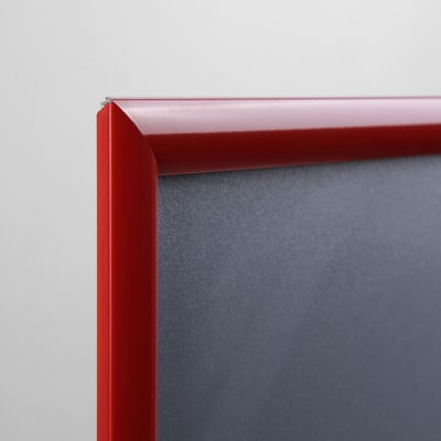 Dettaglio cornice porta pubblicità rossa
